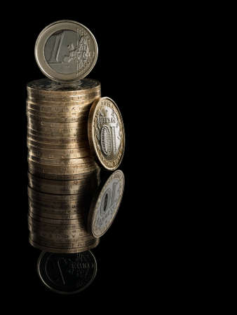 vómito: Heap of ruble coins and euro coin it is isolated on the black