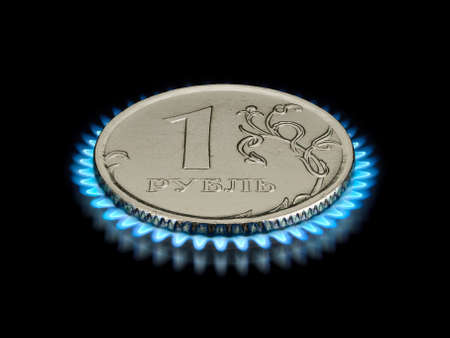 gas flame: Coin in one ruble on a gas flame it is isolated on the black