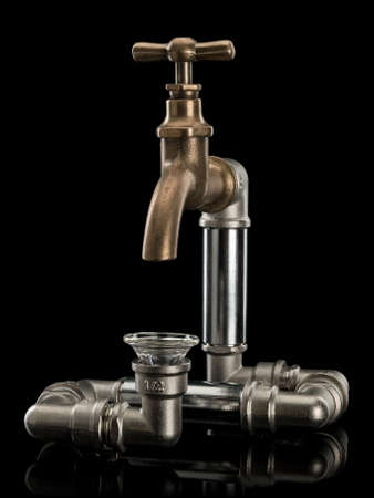 waterpipe: System of water pipes, brass faucet and a funnel from glass it is isolated on