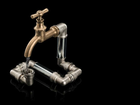 threw: Water stream in the closed water system with brass faucet it is isolated on black Stock Photo