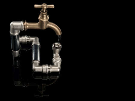 waterpipe: Water stream in the closed water system with brass faucet it is isolated on black Stock Photo