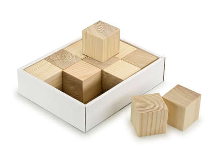 laid: Twelve wooden cubes are laid in a cardboard box is isolated on white