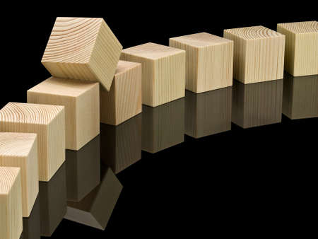 long term: Kind in the long term of some wooden cubes it is isolated on black Stock Photo