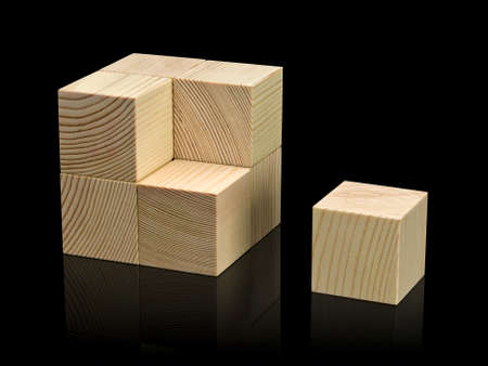 lacking: The combined wooden cubes it is isolated on black Stock Photo
