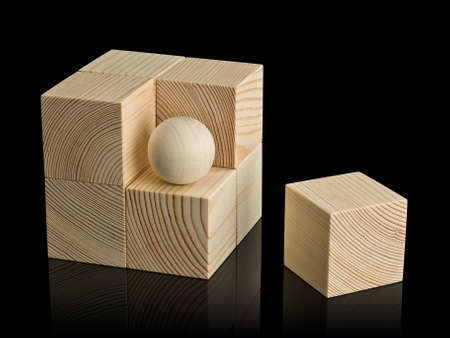 lacking: Eight wooden cubes and the sphere, combined in not the correct form of a cube