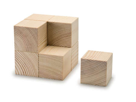 lacking: The combined wooden cubes it is isolated on white Stock Photo