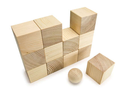lacking: Not completed wall from twelve wooden cubes and wooden sphere Stock Photo