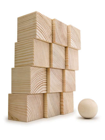 allocated: The big wall combined from wooden cubes against a small wooden sphere