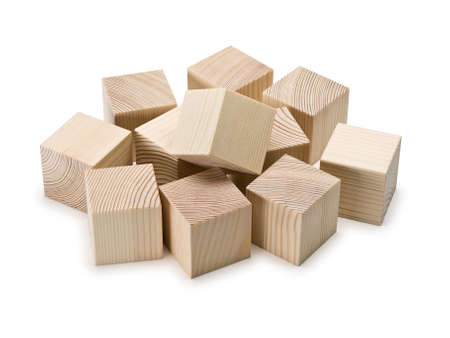 heaped: The wooden cubes, heaped it is isolated on white