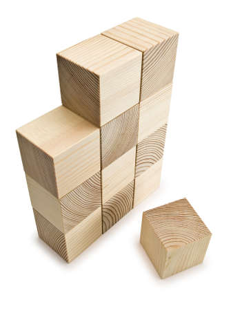 lacking: Not completed wall from wooden cubes Stock Photo