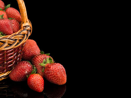 aliments: Fragment of a basket by the filled ripe strawberry it is isolated on black