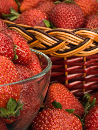 overripe: Close up of the become overripe strawberry in a glass vase and a basket
