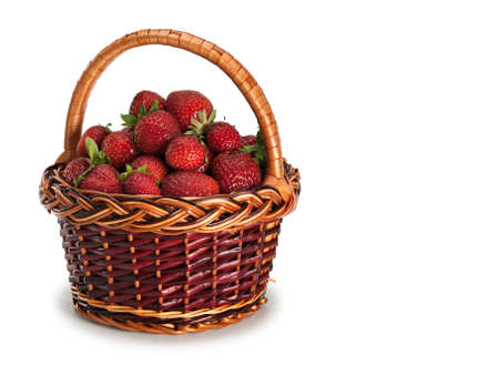 foodstuffs: Basket filled by a strawberry it is isolated on white