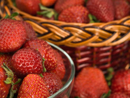 aliments: Close up of the become overripe strawberry in a glass vase and a basket