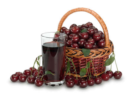 Basket full of a cherry and a glass of cherry juice it is isolated on white