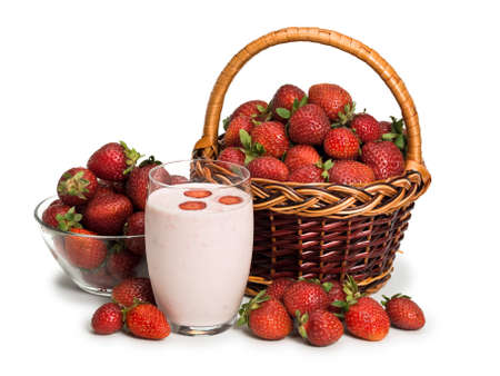 foodstuff: Fruit yoghurt and basket with a vase filled with a ripe strawberry it is isolated on white Stock Photo