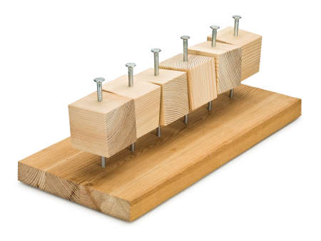 Wooden cubes and board are sewed by steel nails