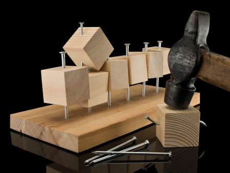 sewn: Wooden cubes, are randomly sewn to panel by means of  hammer and nails