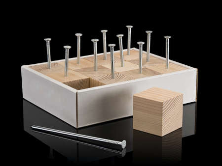 sewn: Wooden cubes are densely sewn by nails to a cardboard box