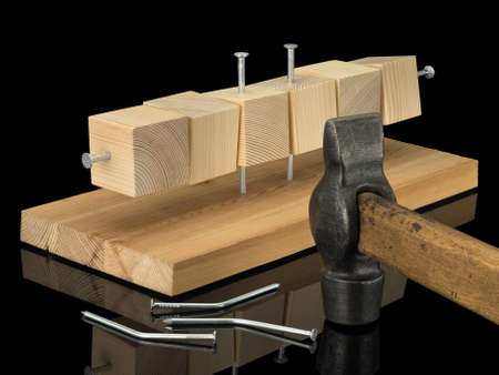 Six wooden cubes are sewed with a board, a hammer, three curve nailing