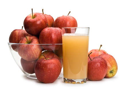 Ripe, red apples in a glass vase and juice with pulp in a glass it is isolated on white