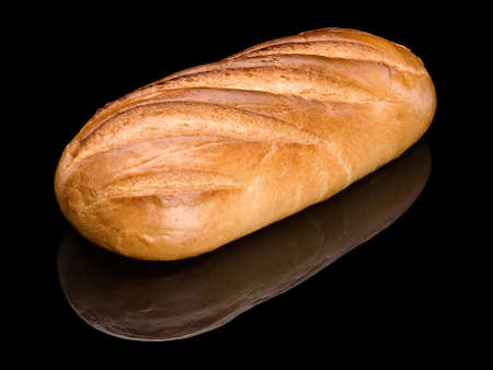 White loaf long loaf, it is isolated on black  Stock Photo