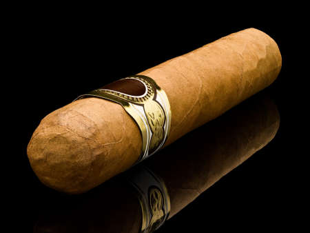 Cigar robusto a closeup a diagonal it is isolated on black  写真素材