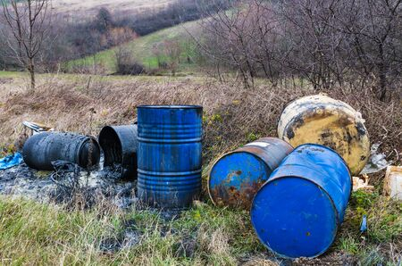 Barrels of toxic waste in nature, pollution of the environment.
