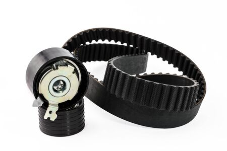 Spare parts for the car. The set of timing belt with rollers on a white background.