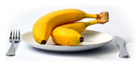 overripe: Overripe banana and orange on the plate with white background