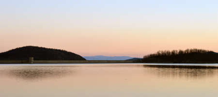 reflecting: Artificial lake in sunset with slightly reflecting background