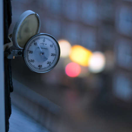 termometer: Window thermometer in cold morning showing -8 degrees Stock Photo