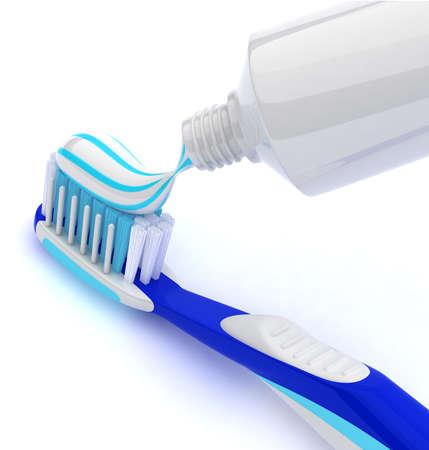 pasta dientes: Exprimir la pasta de dientes en el cepillo de dientes Foto de archivo