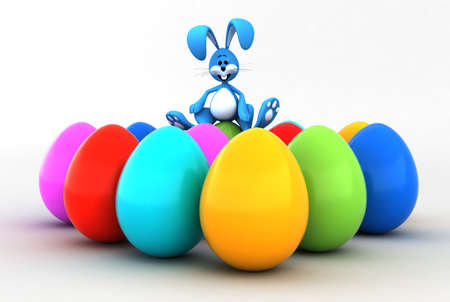 Easter bunny sitting on Easter eggs photo