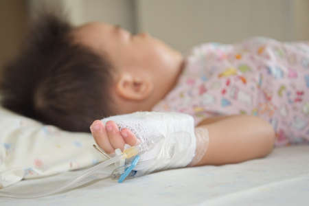 sickbed: Illness little asian (thai) baby asleep on a sickbed in hospital, saline intravenous (IV) on hand