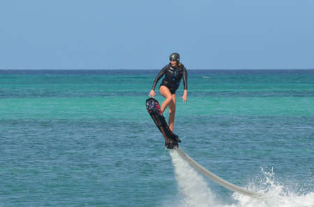Woman on a water hoverboard on Palm Beach Aruba. 写真素材