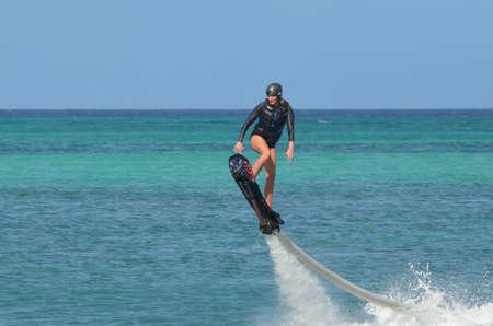 aruba: Woman on a water hoverboard on Palm Beach Aruba. Stock Photo
