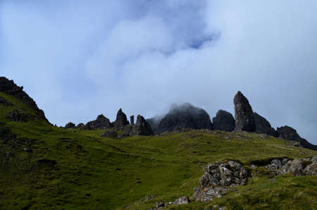 Clouds settling upon the pinnacle rocks of the Old Man of Storr in Scotland.