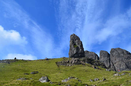 streaking: Pretty landscape and blue skies with streaking clouds over rocks at the Old Man of Storr. Stock Photo