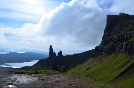 silhoutted: Silhoutted highlands with towering rocks reaching to the clouds.