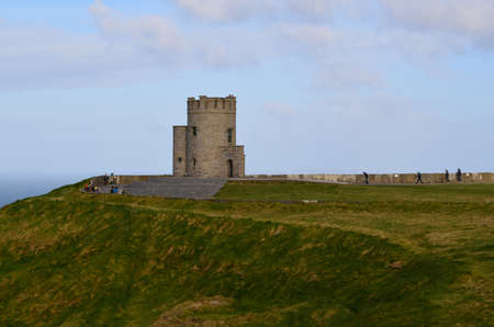lookout: Round lookout tower on the Cliffs of Moher overlooking Galway bay.