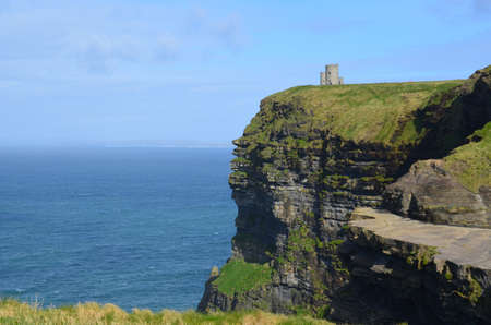 Cliffs of Moher with Obriens Tower over looking Galway Bay. Stock Photo