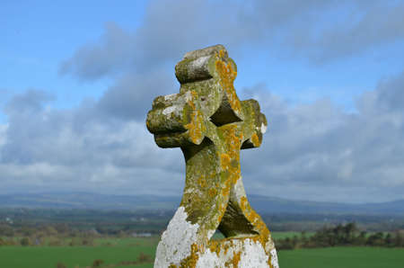irish countryside: Ornate stone Christian cross marking an old burial ground.