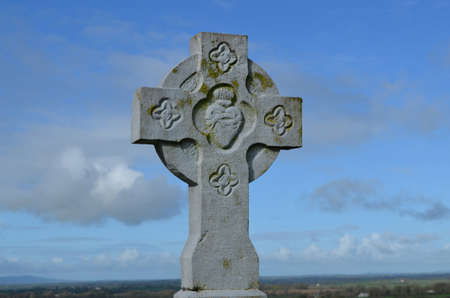 irish countryside: Fancy stone cross standing against the sky.