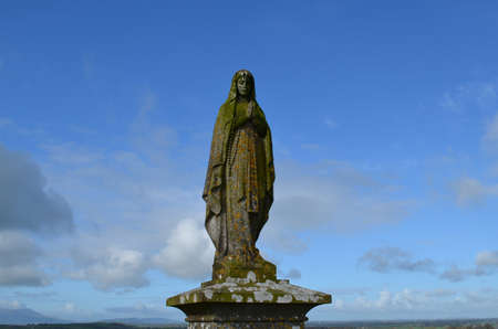 ministry: Statue of Mary in the cemetery at Ireland. Stock Photo