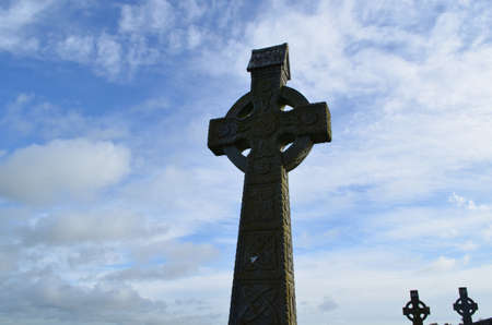 Towering silhouetted celtic crosses in Ireland.