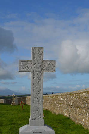 irish countryside: Old graveyard marked by a stone cross in Cashel.