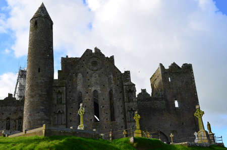 irish countryside: Fluffy white clouds hanging over the Rock of Cashel in Ireland.