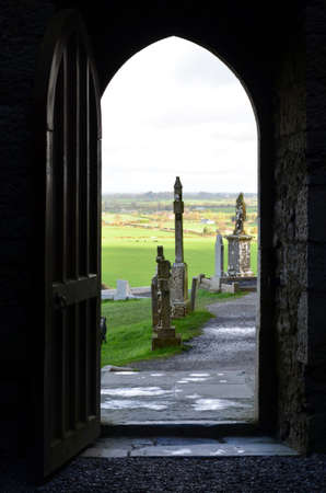 irish countryside: Cemetery outside the doorway of the ruins of the Rock of Cashel.
