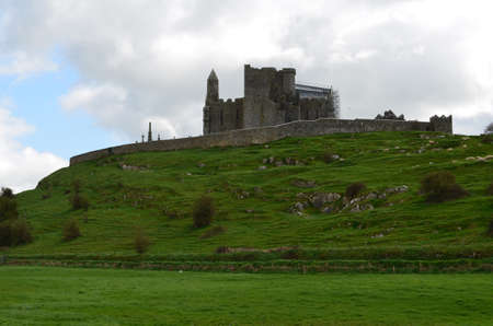 Lush green fields in front of the Rock of Cashel.